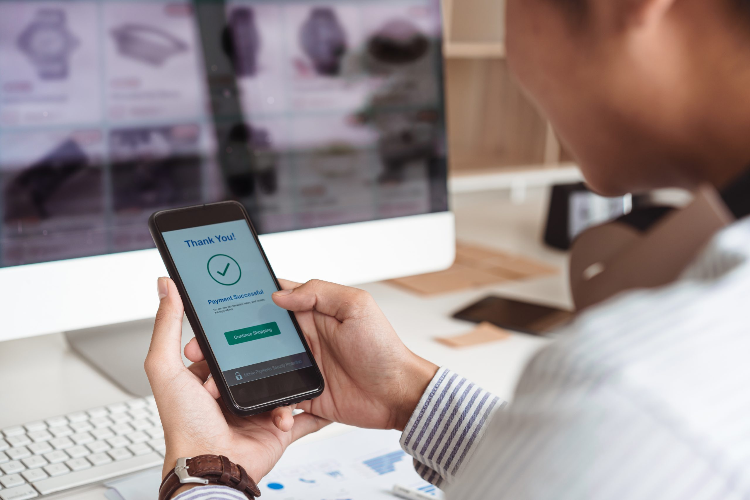 Man's hands holding smartphone and successful online payment. Mobile wallet payment concept.